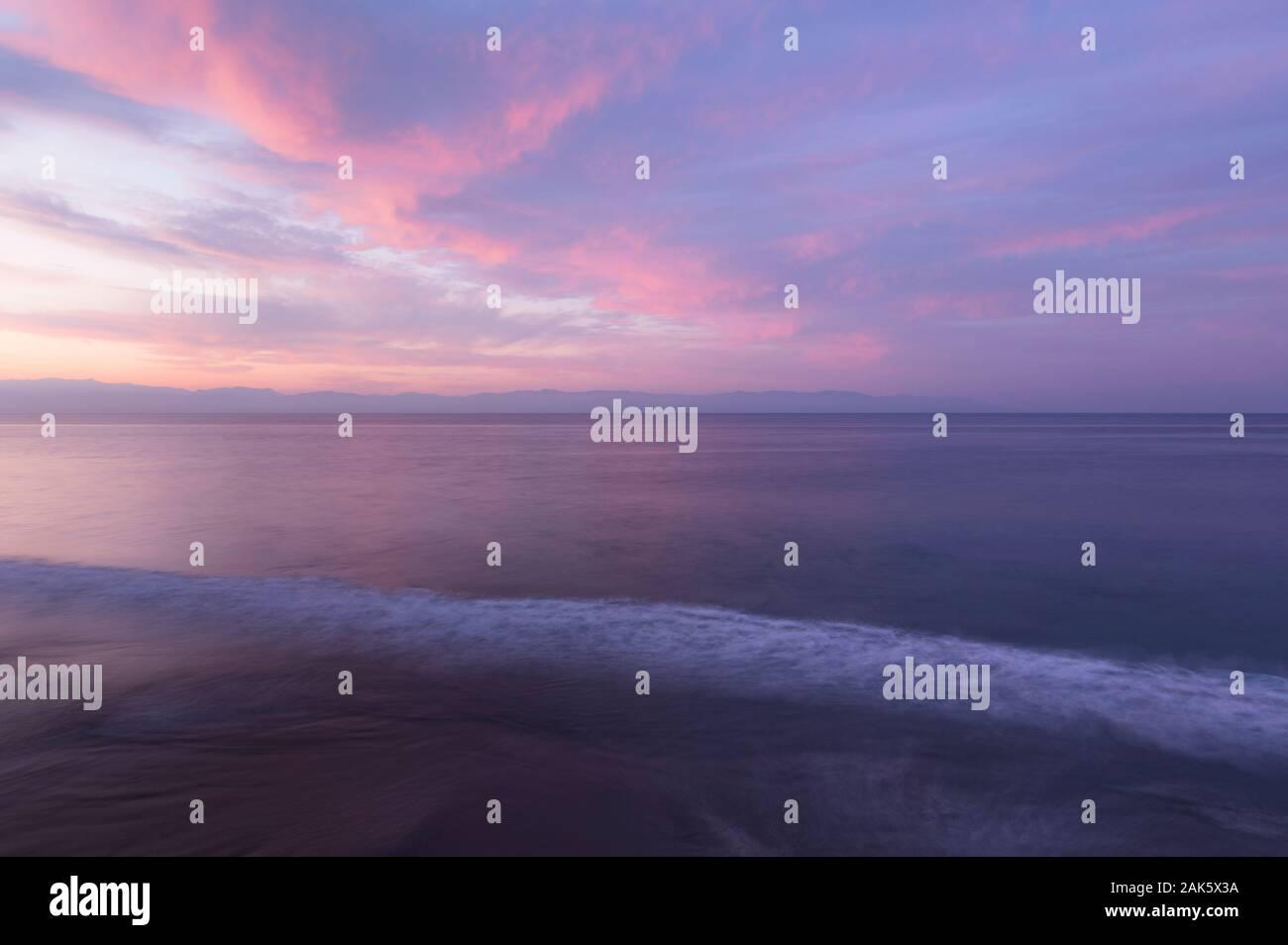 Mexico,Nayarit,Nuevo Vallarta, Pacific Ocean at dawn, pink sky and water Stock Photo