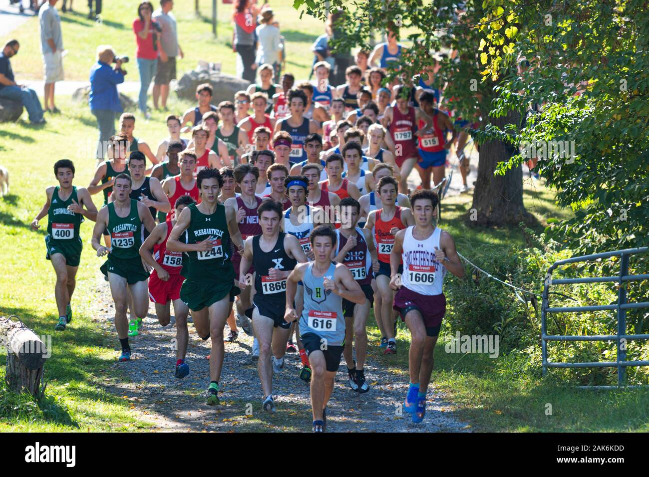 Wappingers Falls, New York, USA - 29 September 2019: The lead pack of boys rounding a corner during a high school cross country race. Stock Photo