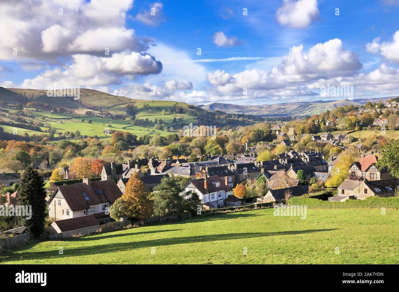 A sunny scenic landscape view of the village of Hathersage and Hope Valley towards Mam Tor and Lose Hill, Peak District National Park, England, UK Stock Photo