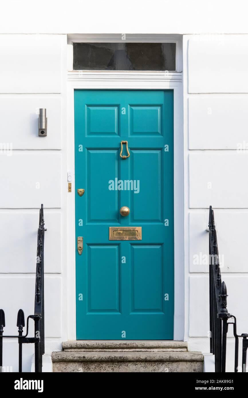 Teal coloured house door. London, England Stock Photo