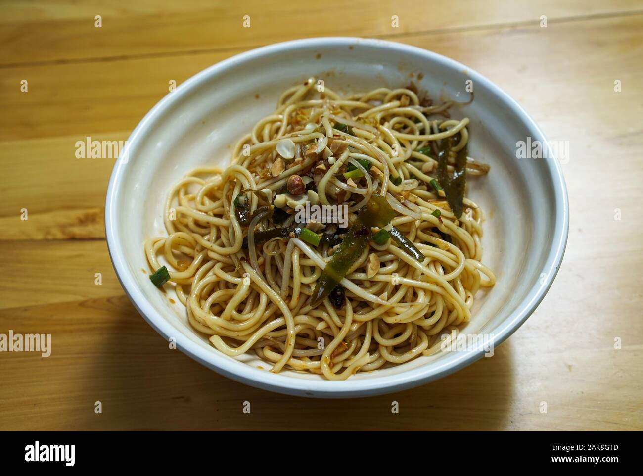 Dan Dan noodle, a spicy Szechuan cuisine dish commonly found in chinese street food. Stock Photo