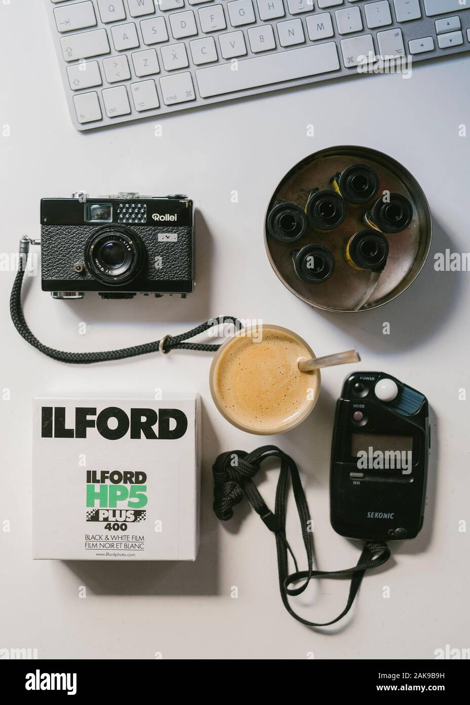 Film photography equipment on a desk Stock Photo