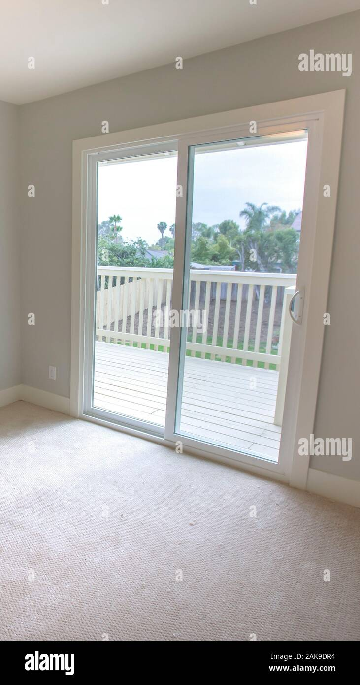 Vertical Frame Empty Bedroom With Sliding Glass Doors On Deck Stock Photo Alamy