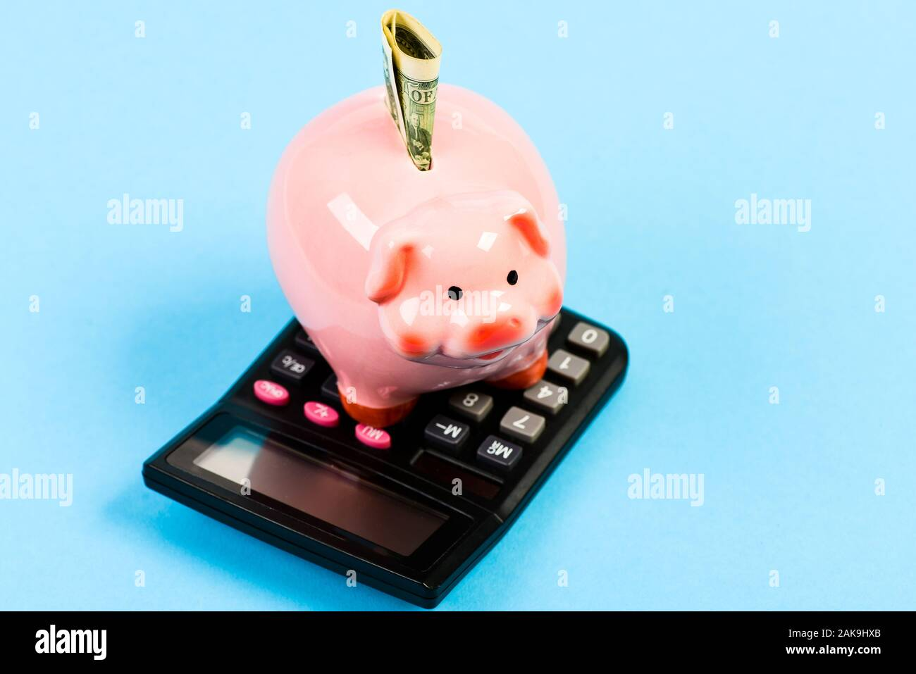 Doing Accounting Business Startup Working With Numbers Piggy Bank With Calculator Moneybox Bookkeeping Financial Report Calculation Of Annual Income Saving Money First Salary Family Budget Stock Photo Alamy