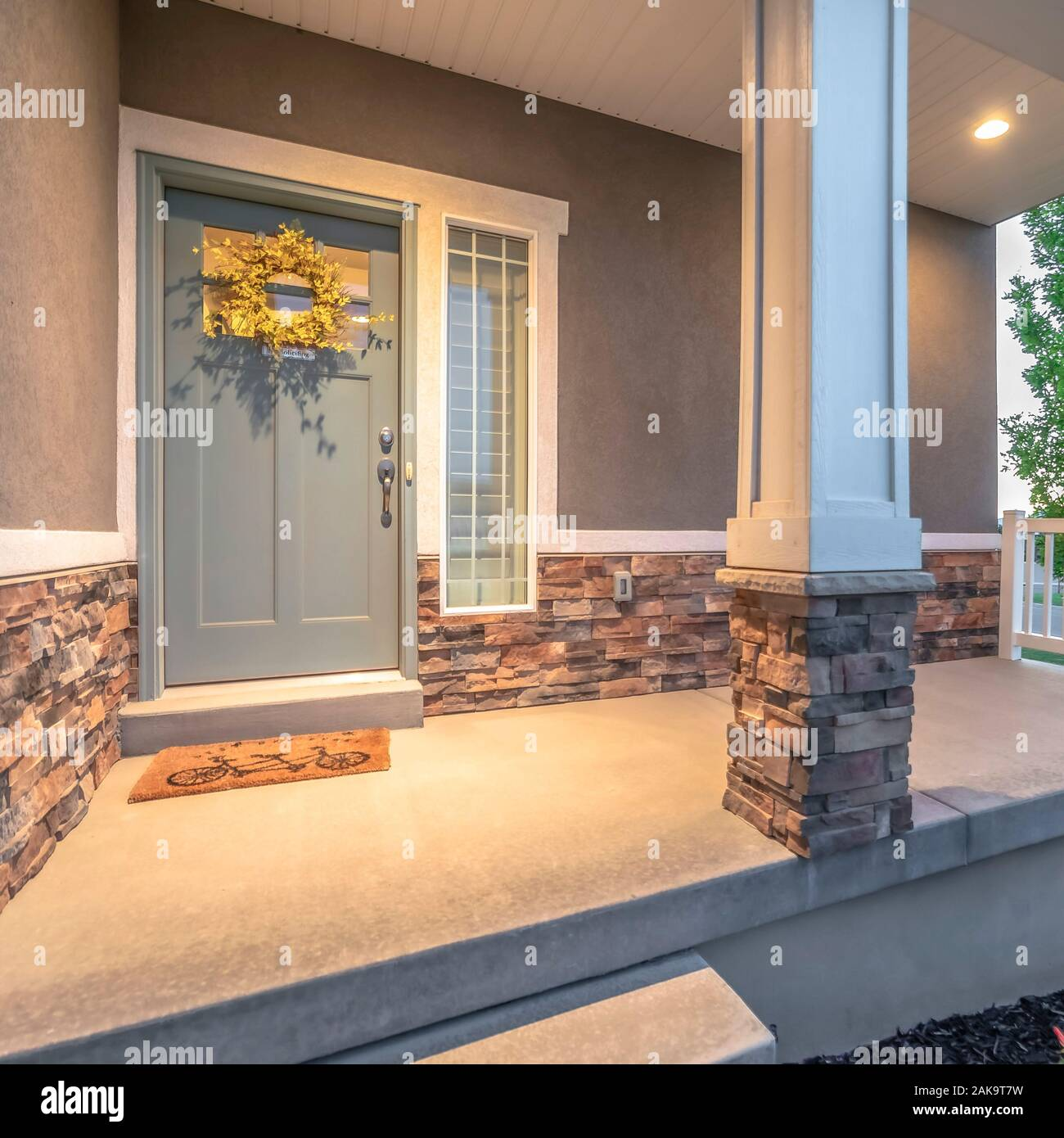 Square Frame Home Facade With Pillars And Railing On The Porch And Wreath On The Gray Door Stock Photo Alamy