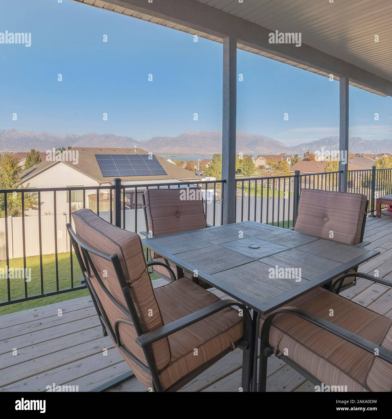 Square Outdoor Dining Furniture On A Covered Patio Stock Photo Alamy