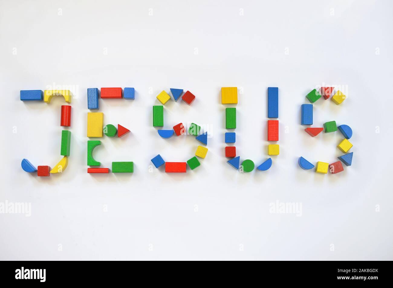 colorful wooden toy blocks lettering the name JESUS Stock Photo