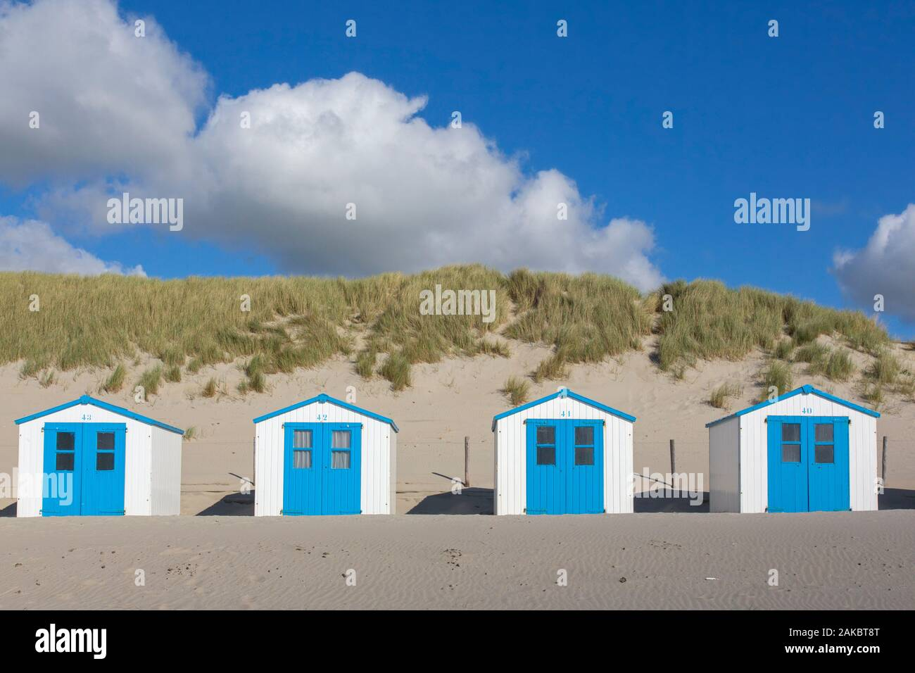 Row of blue and white beach cabins on Texel, West Frisian Island in the Wadden Sea, Noord-Holland, the Netherlands Stock Photo