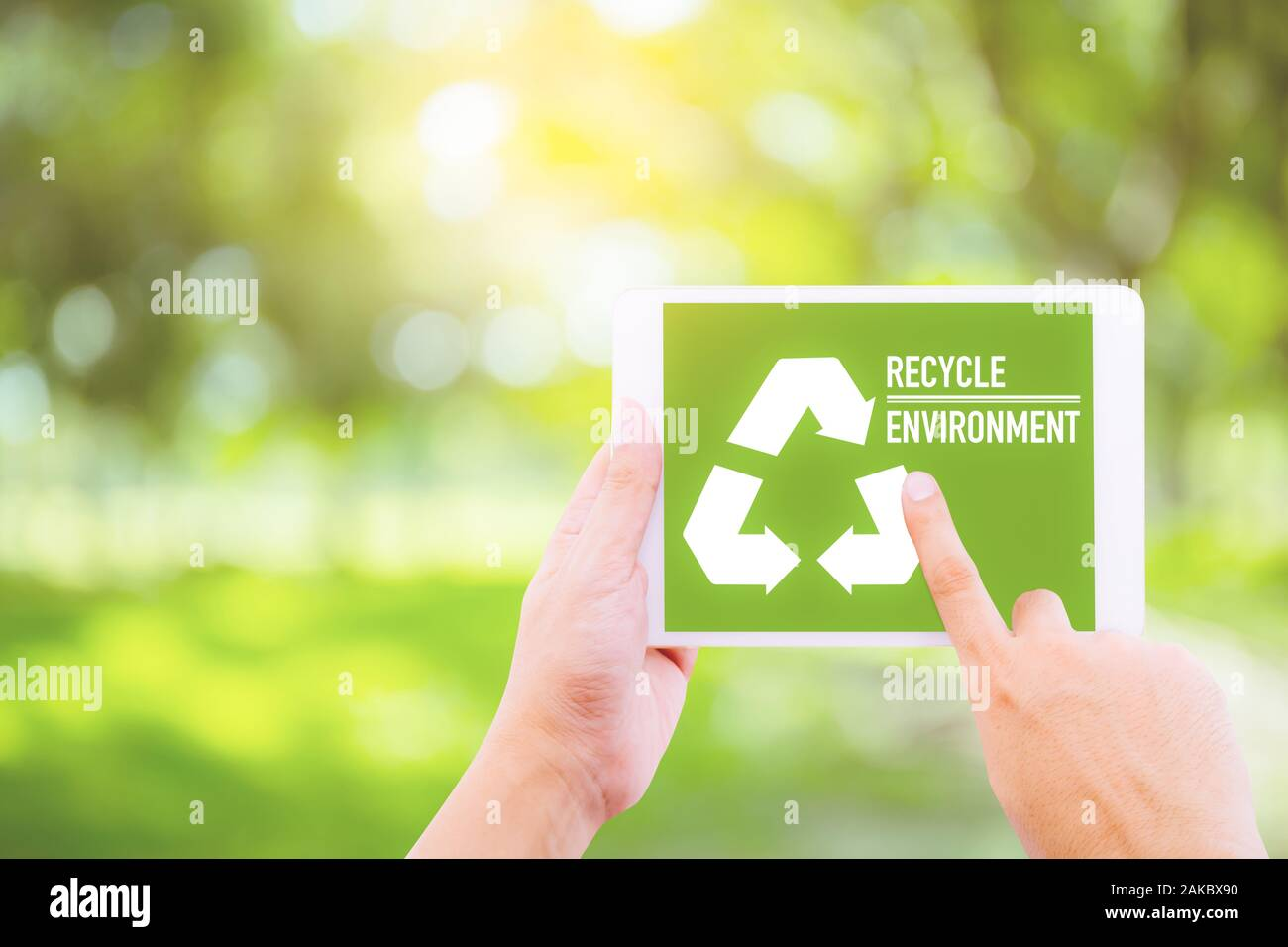 Ecology Friendly Recycle Sign Symbol With Tablet Holding Hand