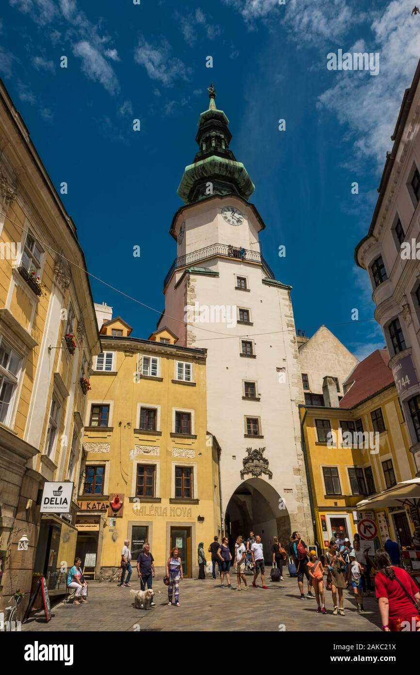 Slovakia, Bratislava, Michalska Street and the Michel Gate (Michalska Brana), a 14th century tower with the octagonal 16th century and the Baroque roof of the 18th century Stock Photo