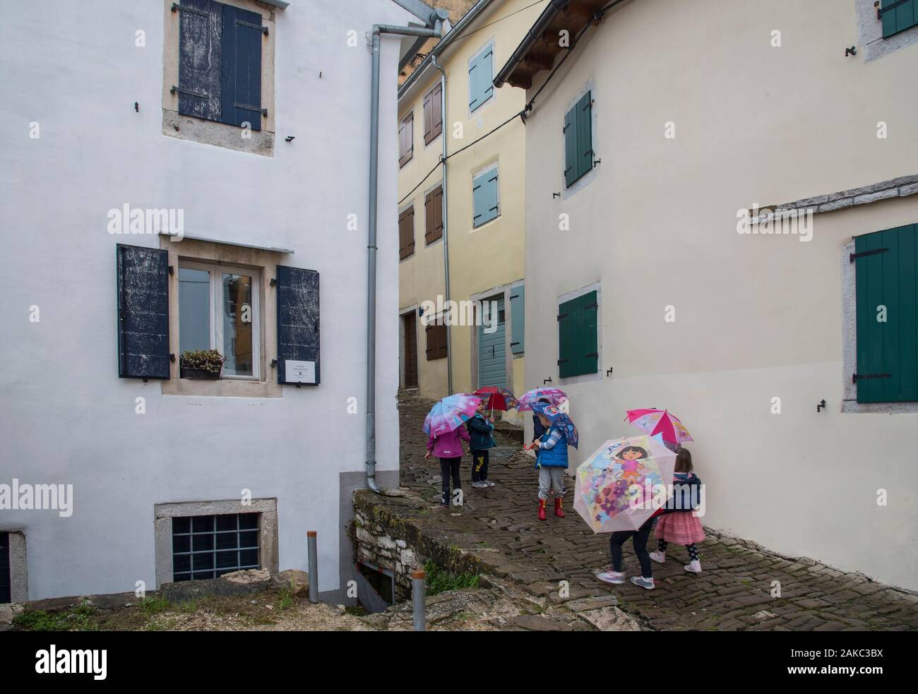 Croatia, Istria, Motovun a group of schoolchildren in the rain in the alleys of the village Stock Photo