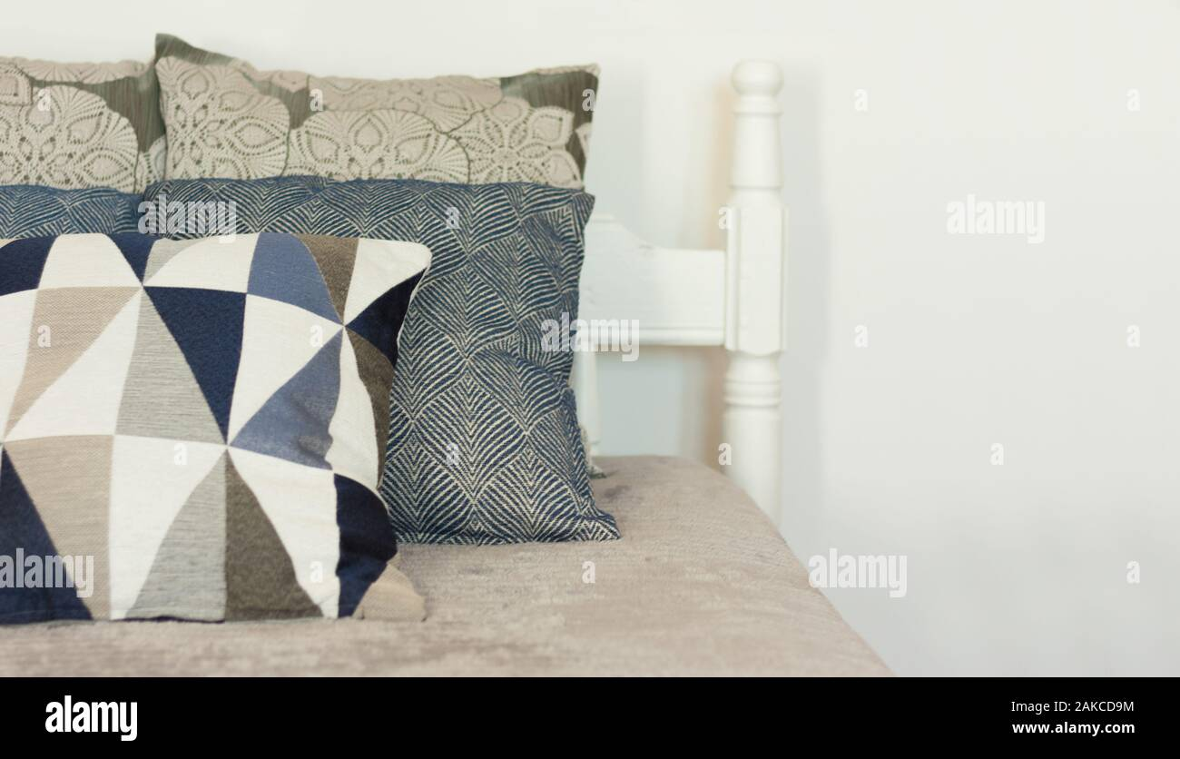 Bedroom Decor Blue And Gray Pillows Are Lying On The Cover On Wooden Bad Near The White Wall Cozy Home Modern Minimalistic Scandinavian Interior Stock Photo Alamy