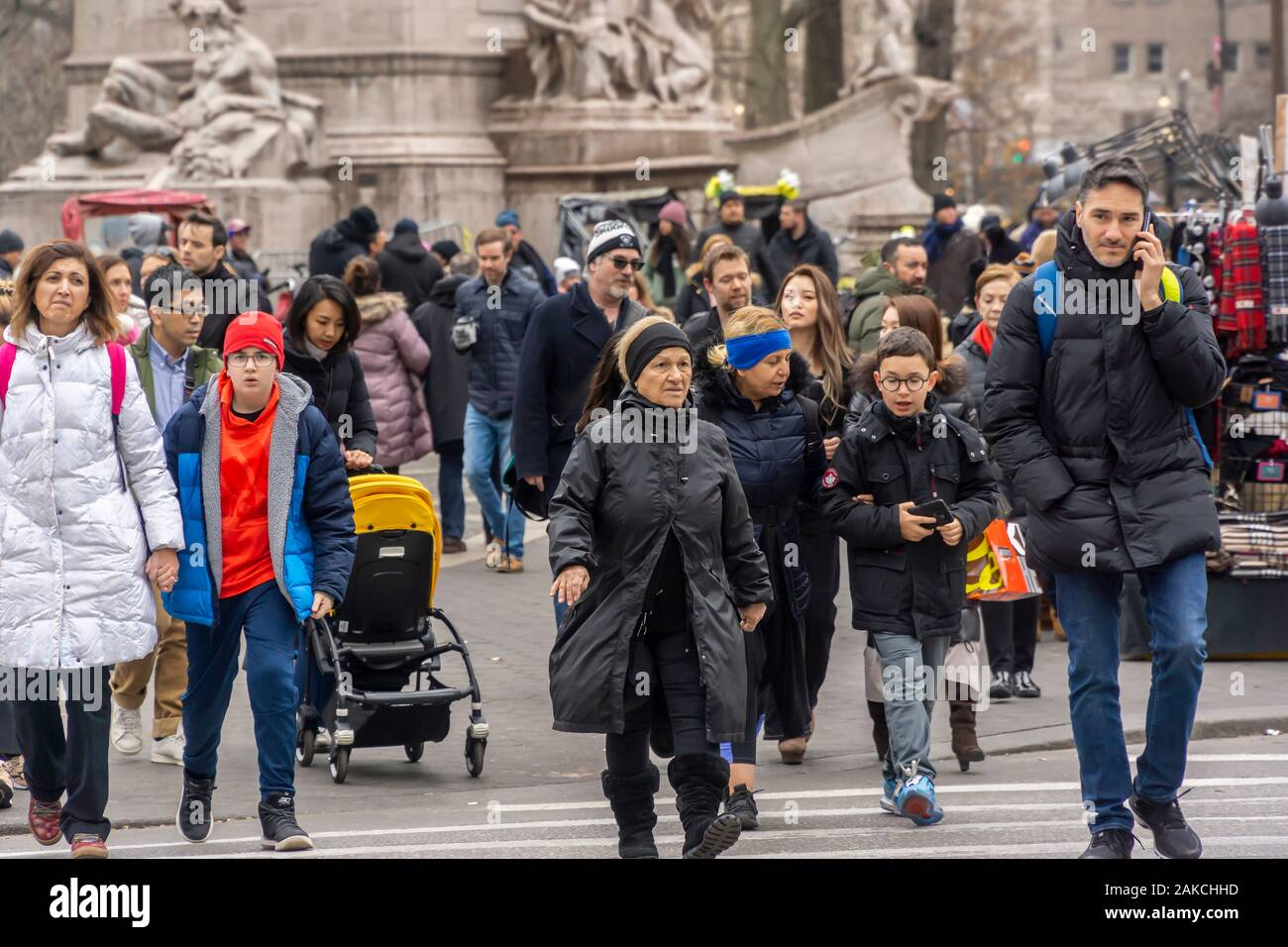 Crowds cross Columbus Circle New York on Sunday, December 29, 2019. (© Richard B. Levine) Stock Photo