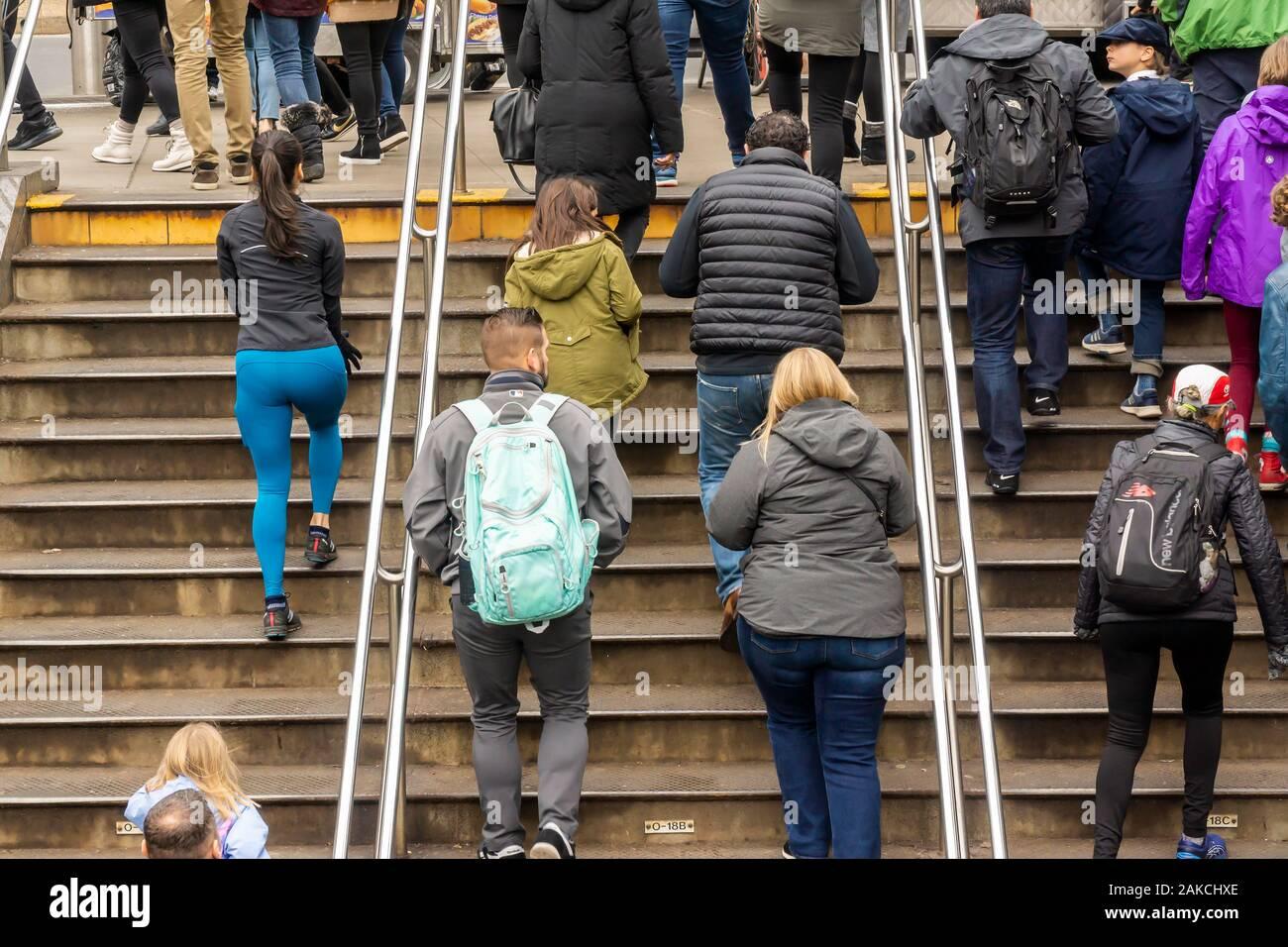 Crowds leave the subway at Columbus Circle New York on Sunday, December 29, 2019. (© Richard B. Levine) Stock Photo