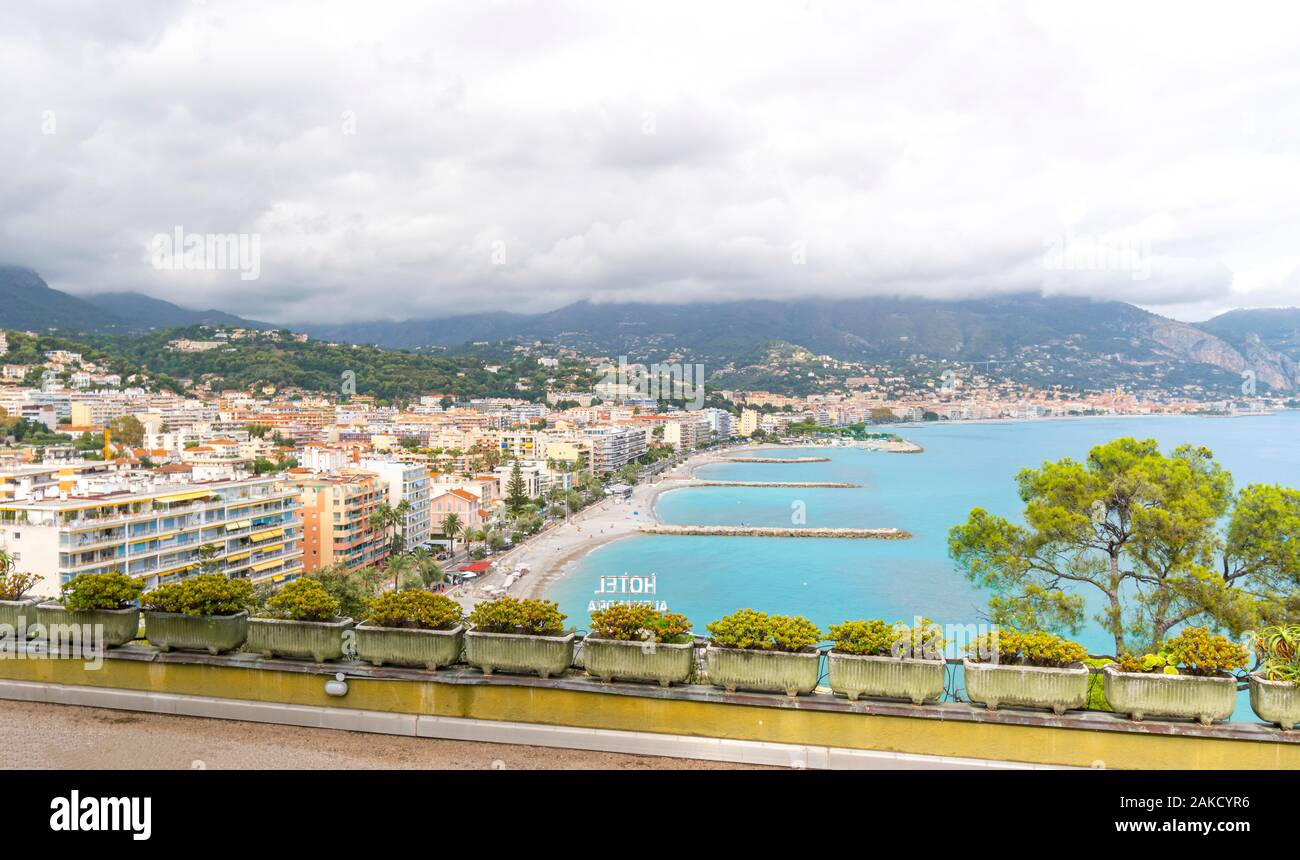 Scenic view from the highway looking down on the Riviera resort town of Roquebrune-Cap-Martin, France, on an overcast summer day. Stock Photo