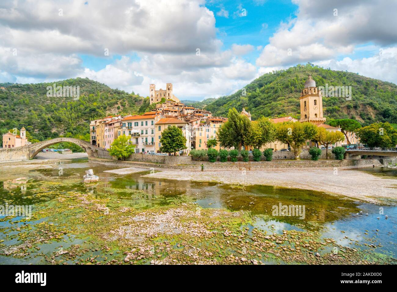 The medieval village of Dolceacqua, Italy, showing the San Fillipo Church, hilltop Castello castle, arched Monet bridge, and the ancient cathedral. Stock Photo