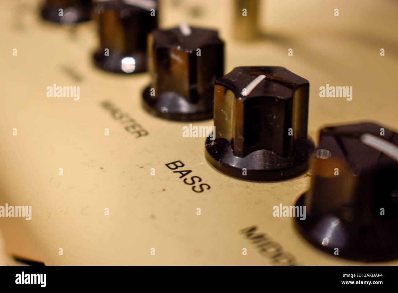 Close up of control knobs on an amp or amplifier for electric and bass guitars Stock Photo