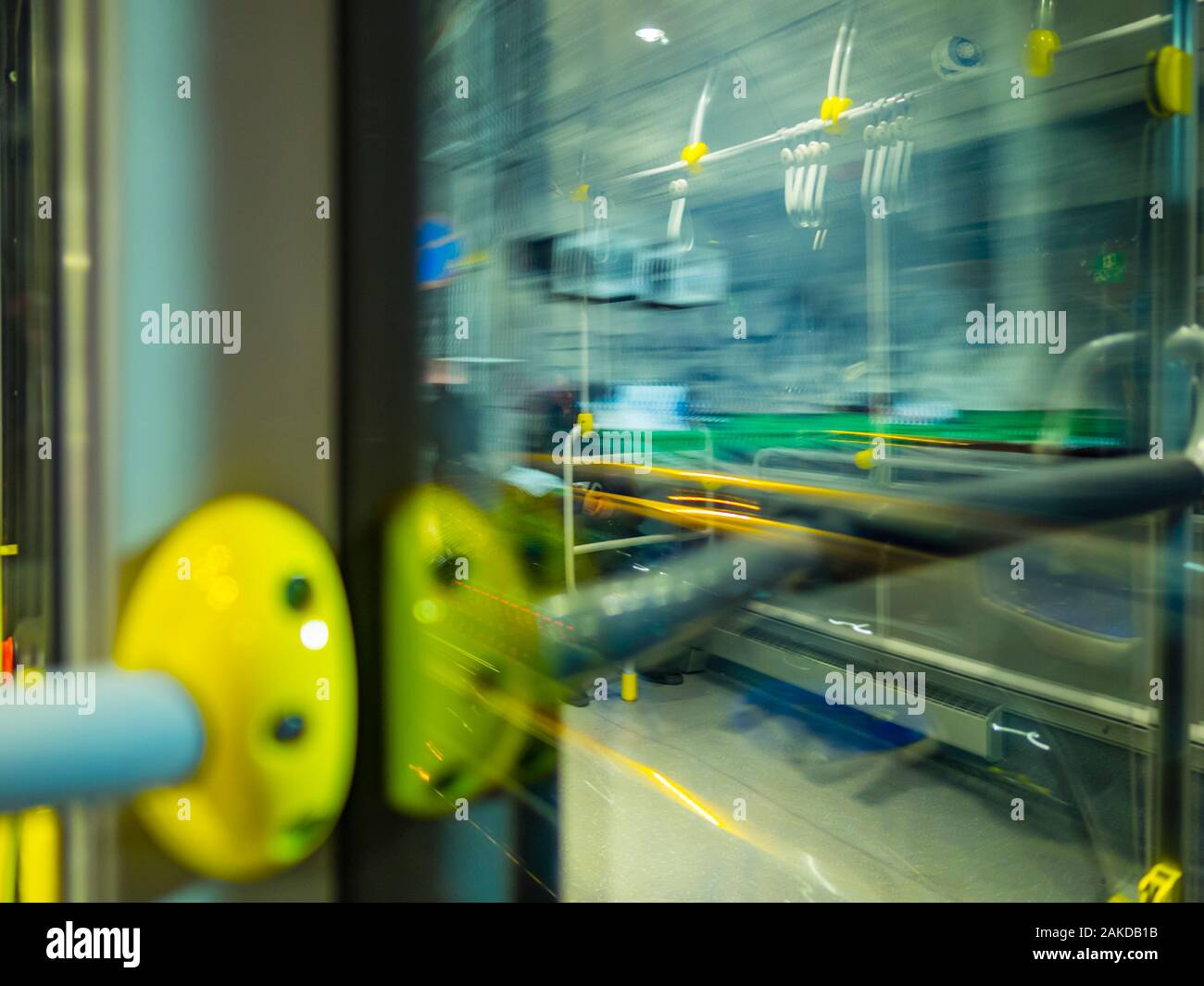Passenger view from bus through window city town urban street motion moving driving intentionally blurry blur background Stock Photo