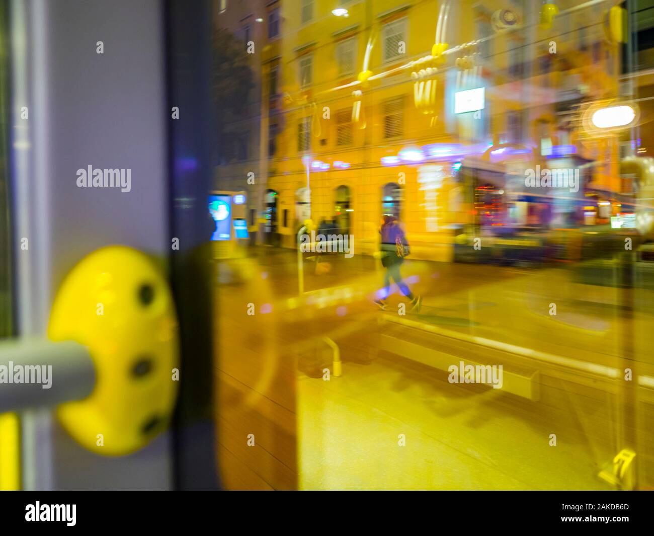 Run running walking for bus passenger view from bus through window city town urban street motion moving driving intentionally blurry blur background Stock Photo