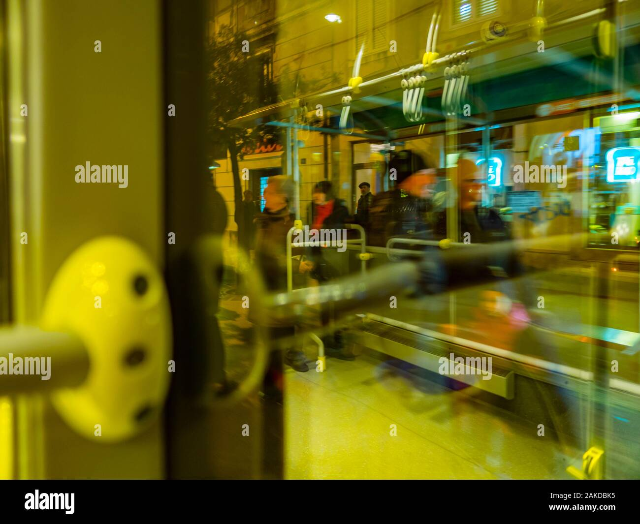 Passenger view from bus through window city town urban street background busstop stop people waiting reflection reflections Stock Photo