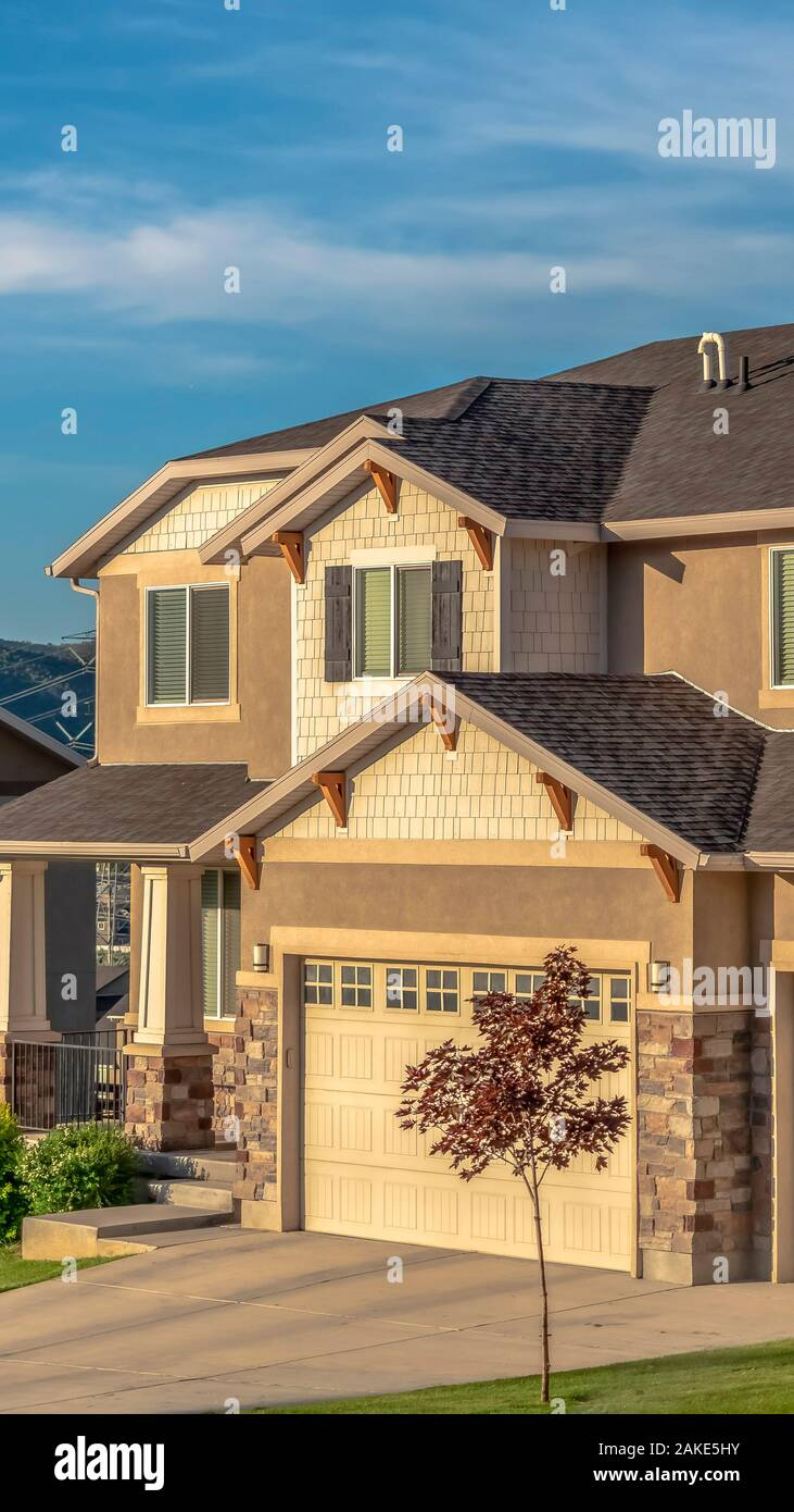 Vertical Beautiful House Exterior With Concrete And Stone Brick Wall Against Blue Sky Stock Photo Alamy