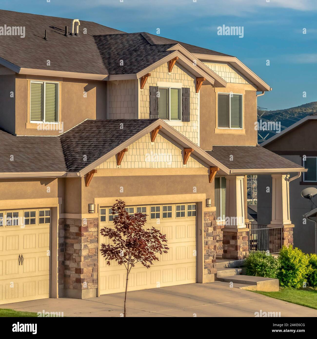 Square Frame Beautiful House Exterior With Concrete And Stone Brick Wall Against Blue Sky Stock Photo Alamy