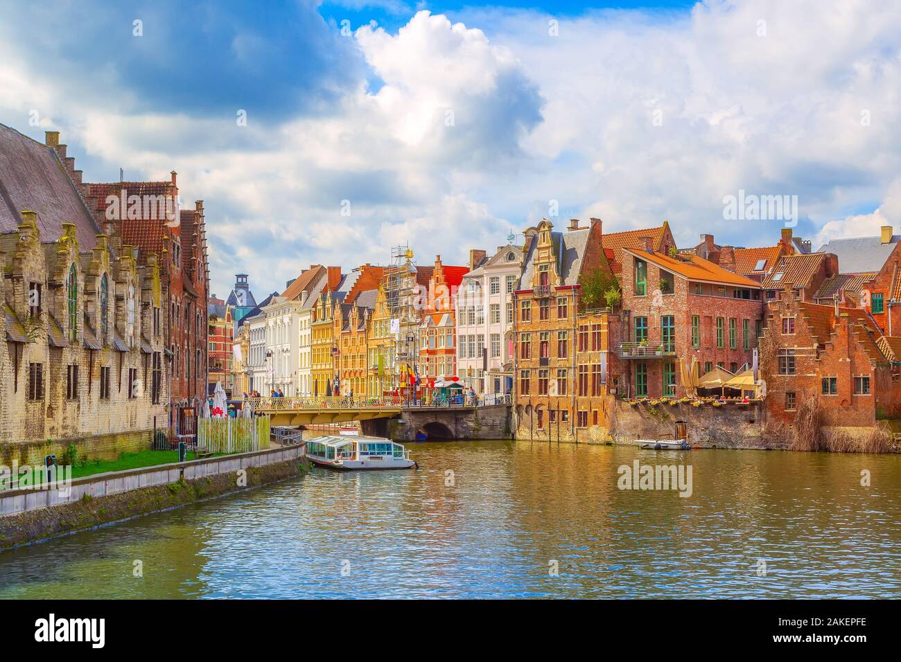 Ghent, Belgium old colorful traditional houses panorama along the canal and boats in popular touristic destination Stock Photo