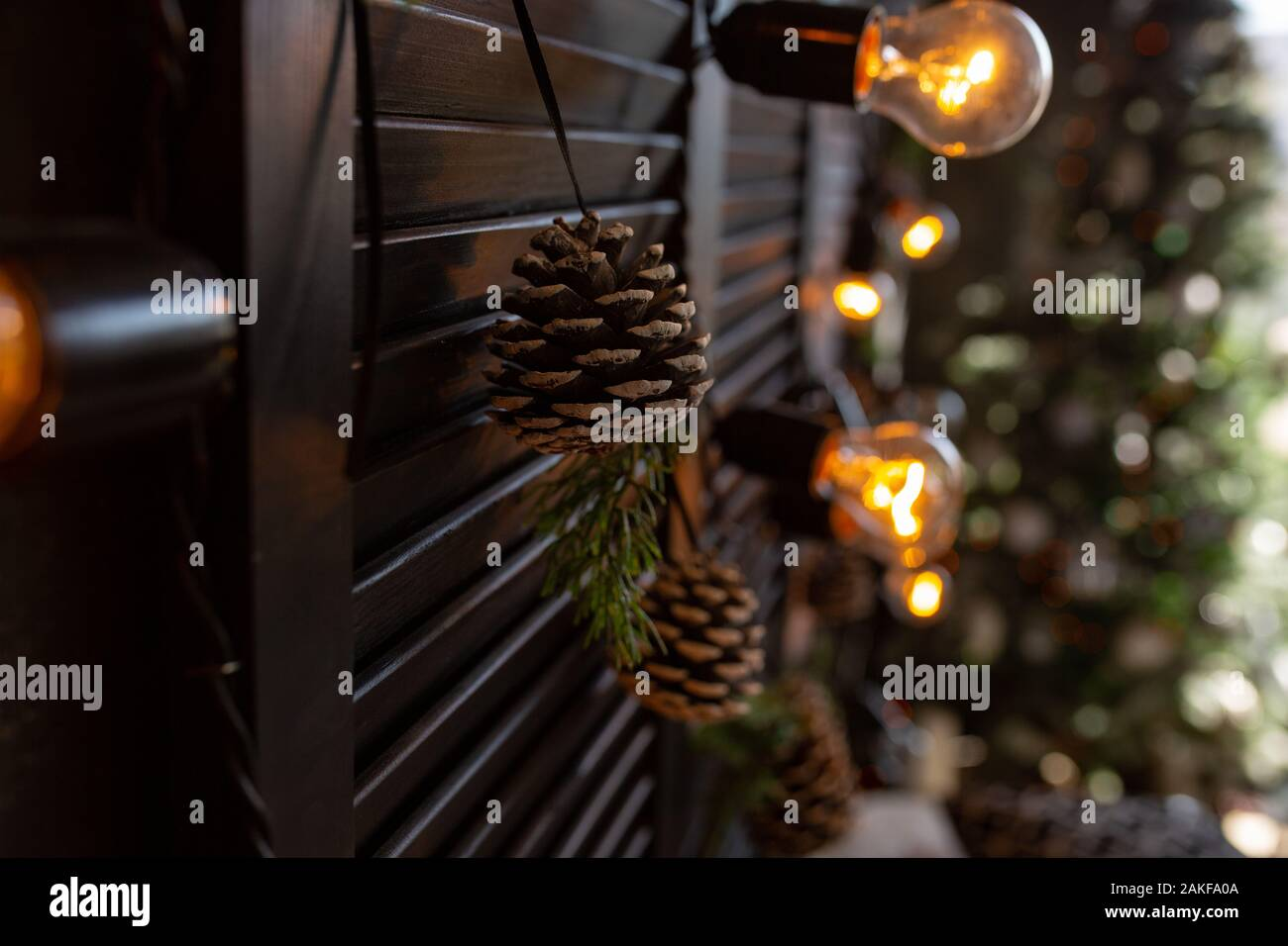 Christmas Decor Bedroom In Dark Colors With Large Bed The Interior Is Decorated With Garlands And A Small Christmas Tree Modern Style Cozy Christm Stock Photo Alamy