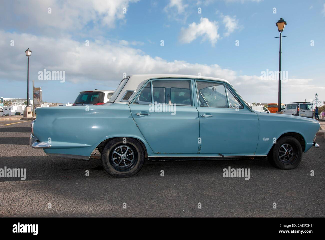 1960's Model Light Blue White Mark One Ford Cortina Motor Car right hand passengers side view of rusty lhd left hand drive four door 4 door ford corti Stock Photo
