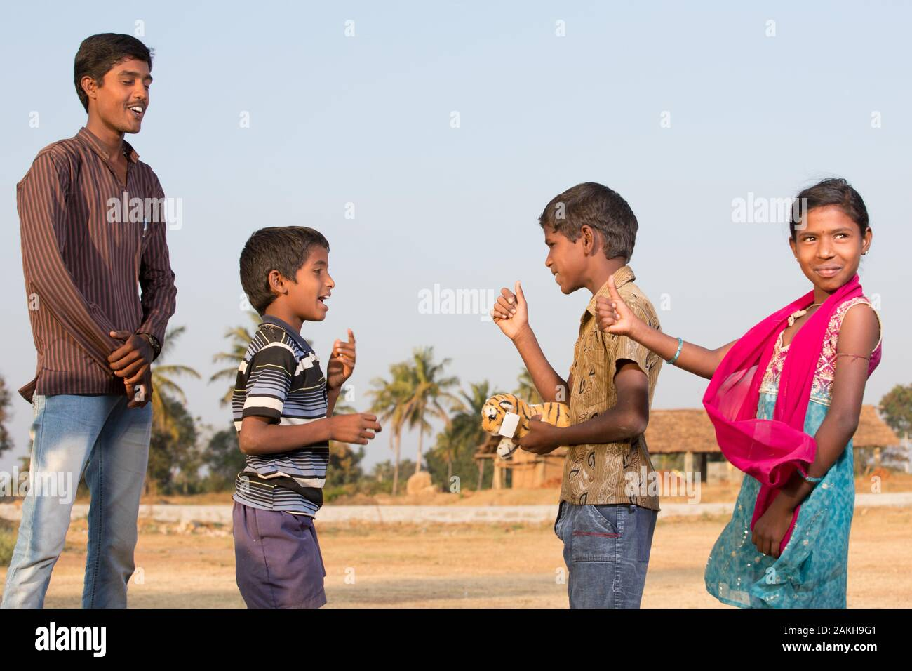 CAPTION: As After-School Club (ASC) Coordinator Ravikumar observes, Mahadev Swamy - who has speech and hearing difficulties - engages with non-disable Stock Photo
