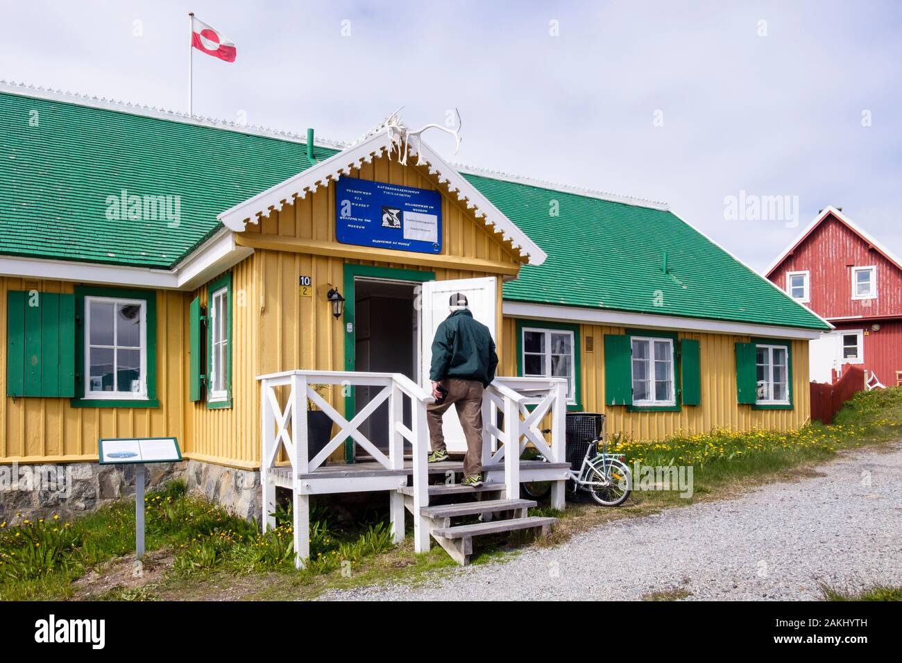 Tourist visiting traditional building former Governors Residence 1839 of Katersugaasivat museum in Paamiut (Frederikshåb), Sermersooq, Greenland Stock Photo