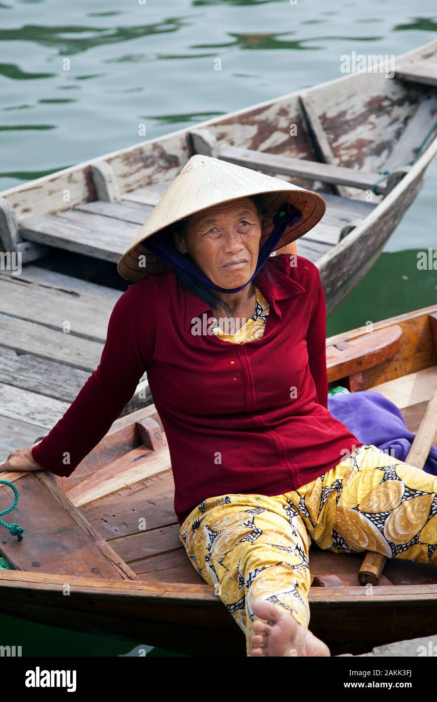 Vietnamese woman taking tourists for rides on the river in the town of Hoi An, Vietnam Stock Photo