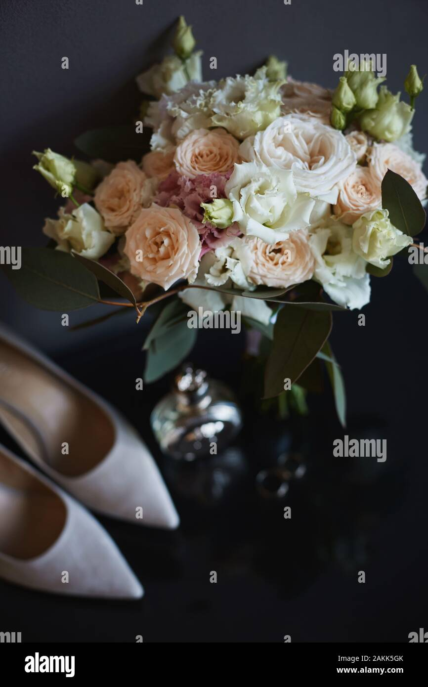 Beautiful Bouquet Of Fresh Roses Peonies Eucalyptus Flowers In Pastel Pink And Cream Colors And Other Bridal Accessories Wedding Rings Bridal Stock Photo Alamy
