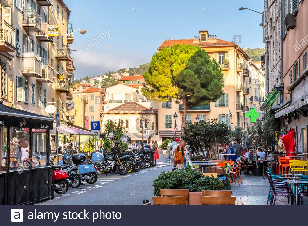 Cafes and shops fill the crowded historic center of Old Town Vieux Nice on the French Riviera in Nice, France. Stock Photo