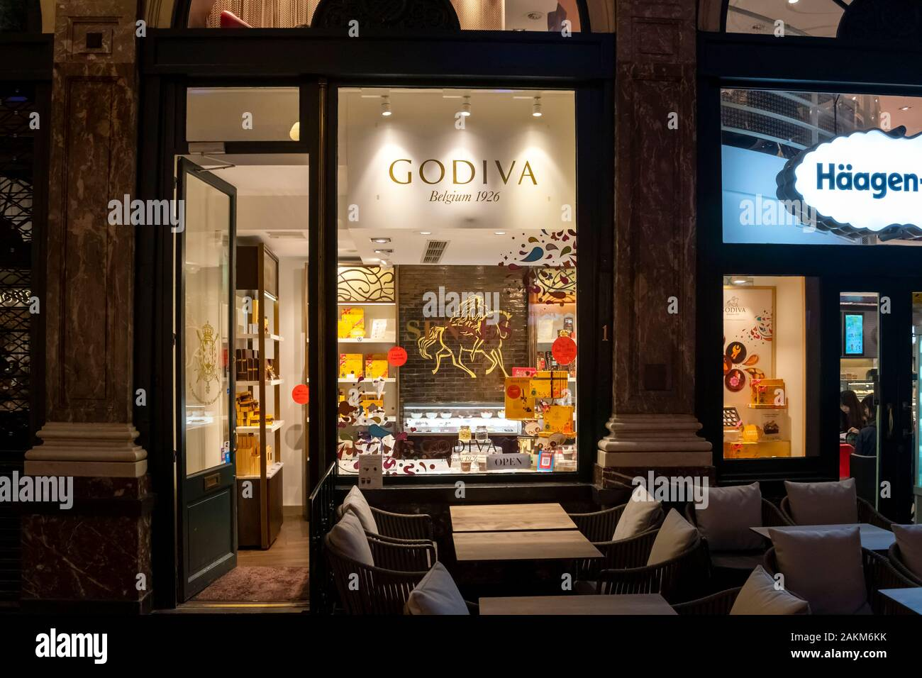 A retail Godiva Chocolate shop storefront in the indoor Galeries Royales Saint-Hubert shopping mall in Brussels Belgium. Stock Photo