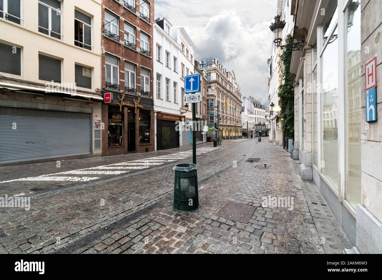 An empty street in the historic center of Brussels, Belgium on an overcast rainy morning. Stock Photo