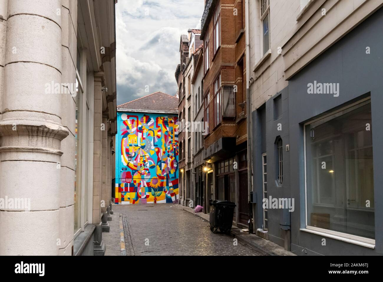 A colorfully painted wall at the end of a street alley on a rainy day in the historic center of Brussels, Belgium. Stock Photo