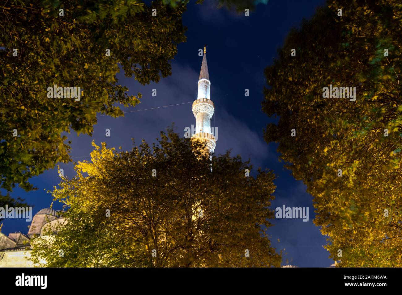 A single minaret rises into the night sky in the Sultanahmet district of Istanbul Turkey. Stock Photo