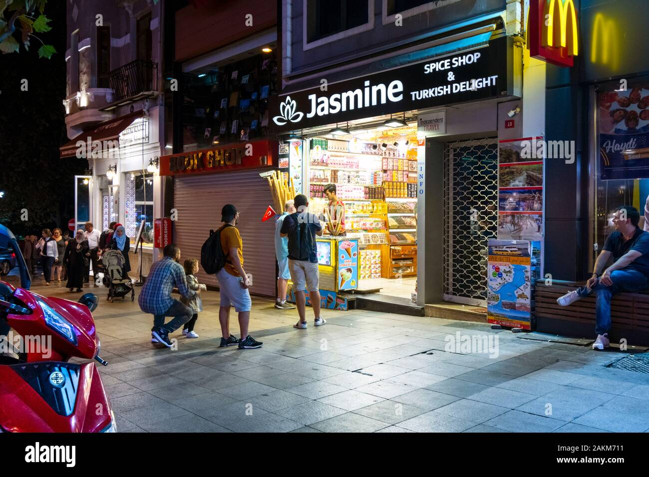 A Turkish ice cream salesman sells from a spice and candy shop late night in the Sultanahmet district of Istanbul, Turkey Stock Photo