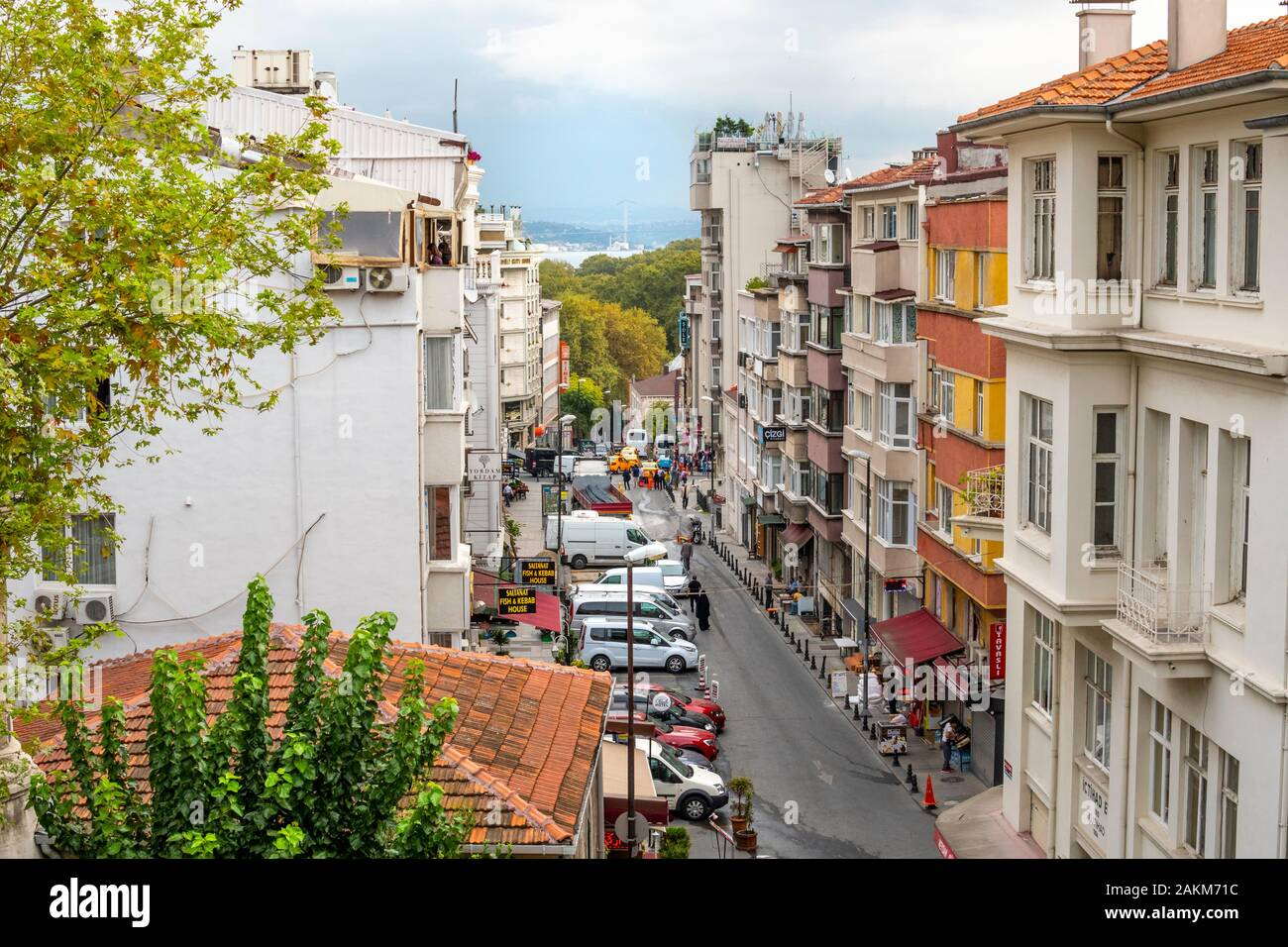 View from an upper level window overlooking a busy street in Istanbul, Turkey, with the Bosphorus Bridge and Golden Horn in the distance. Stock Photo