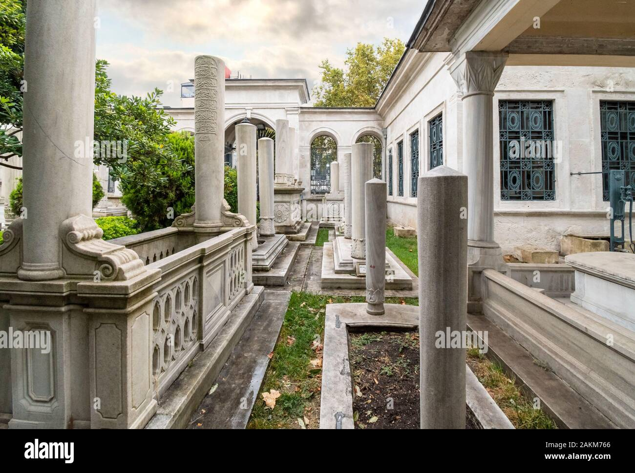 Historic interior courtyard of the Ahmet Tevfik Paşa Tomb filled with marbled headstones, graves and memorials to Turkey's rulers and sultans. Stock Photo