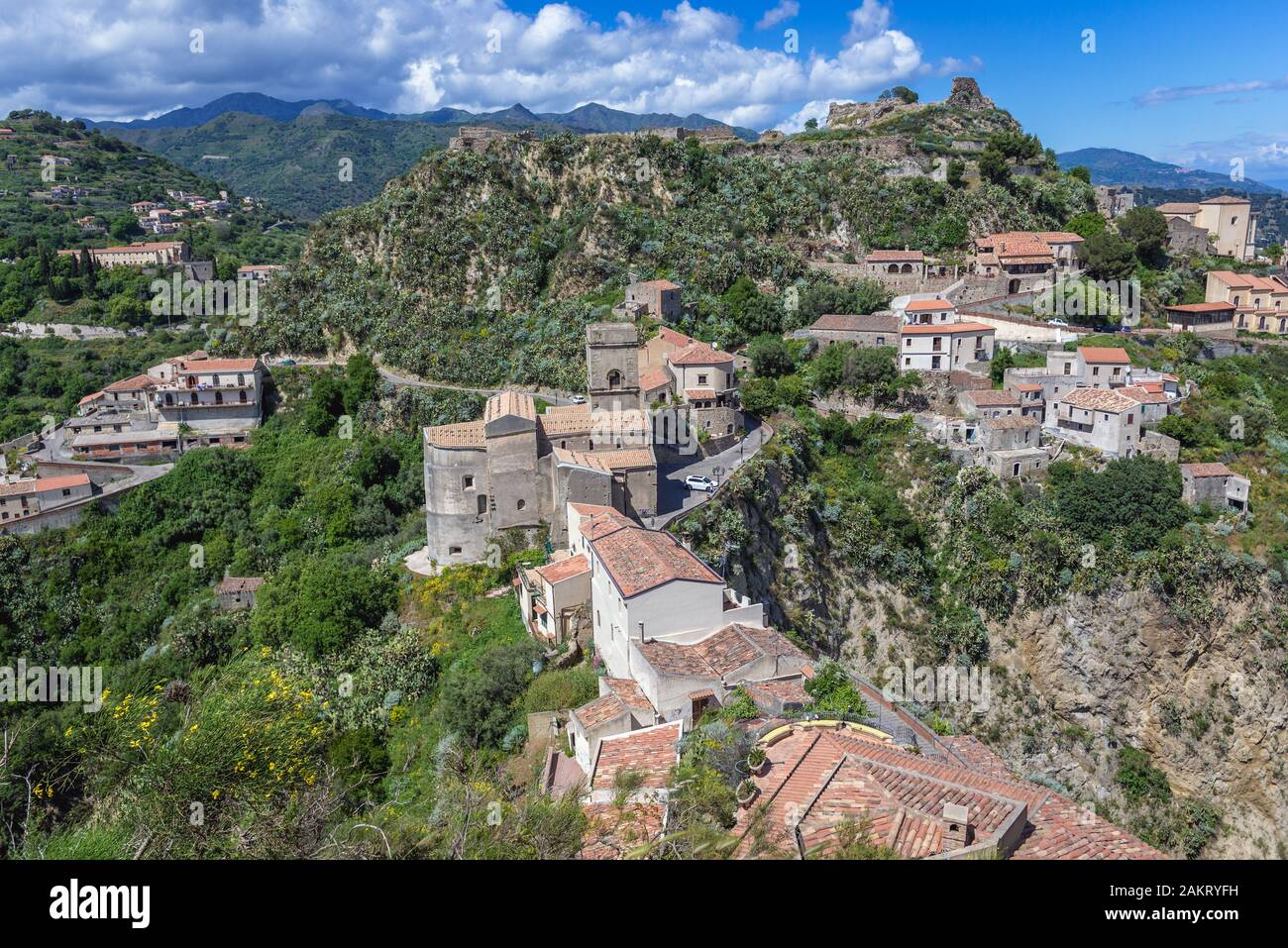 Savoca village on Sicily Island in Italy - view with ruins of Pentefur castle on a hill and Chiesa Madre di Savoca church on foreground Stock Photo
