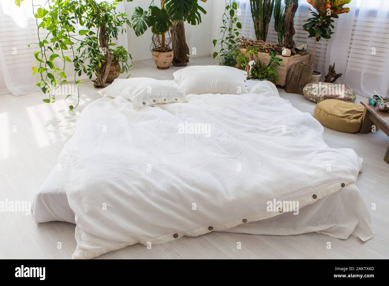 natural eco-friendly linen bed in the interior Stock Photo