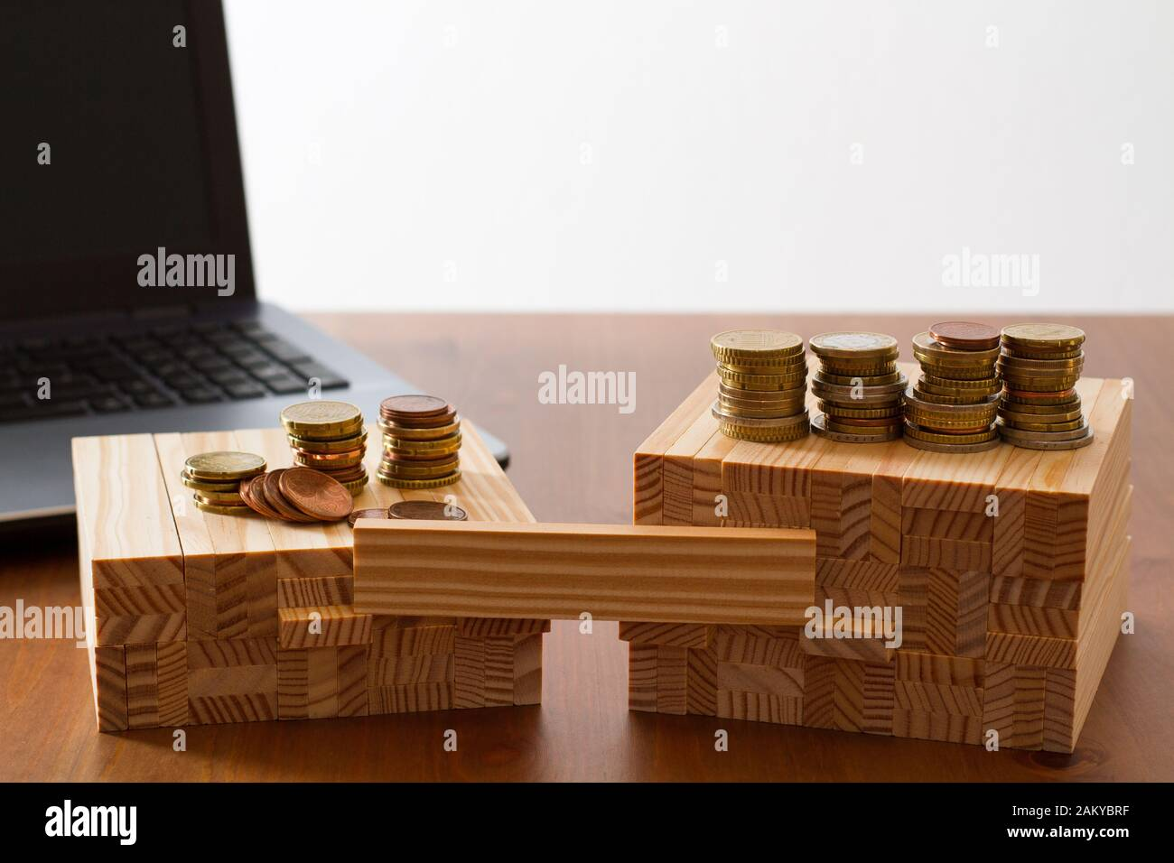 wooden building bricks arranged to symbolize gender gap, discrimination, unequal pay, inequality, or similar business/social Topics with one brick lef Stock Photo