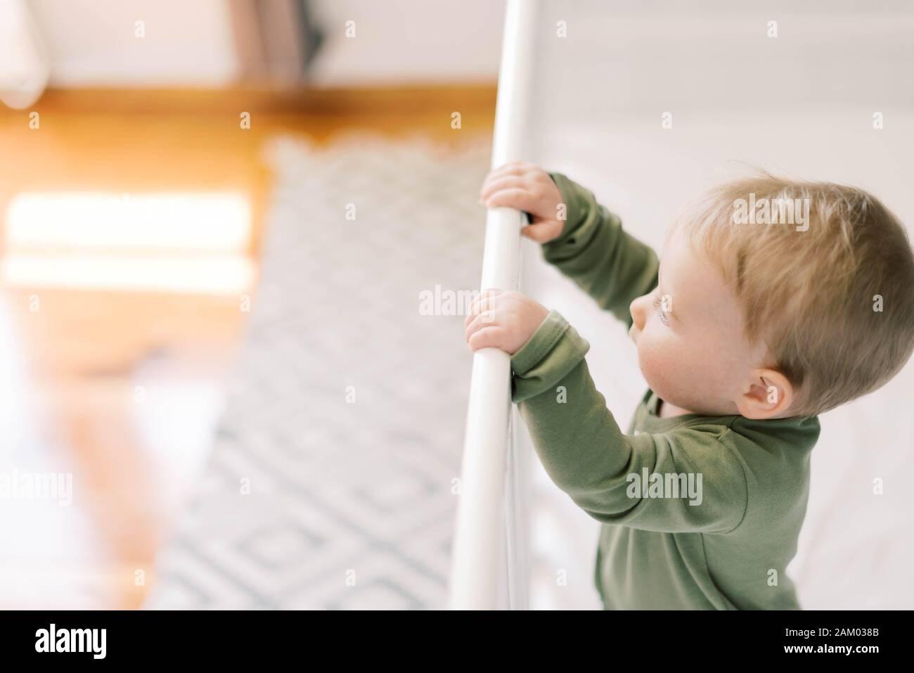 Little baby girl in her nursery. Stock Photo