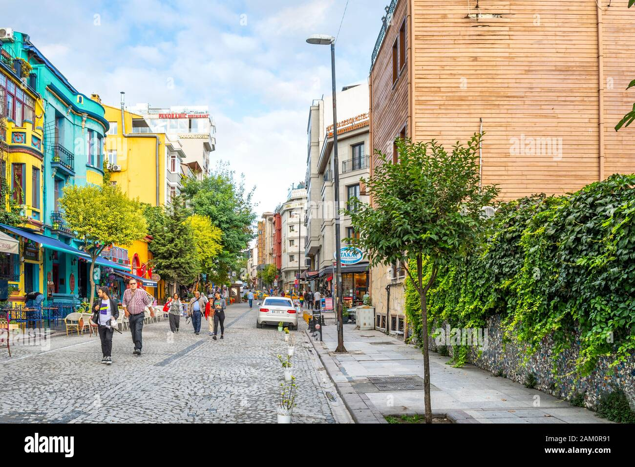 A street full of colorful shops and cafes in the historic Sultanahmet district of Istanbul, Turkey. Stock Photo