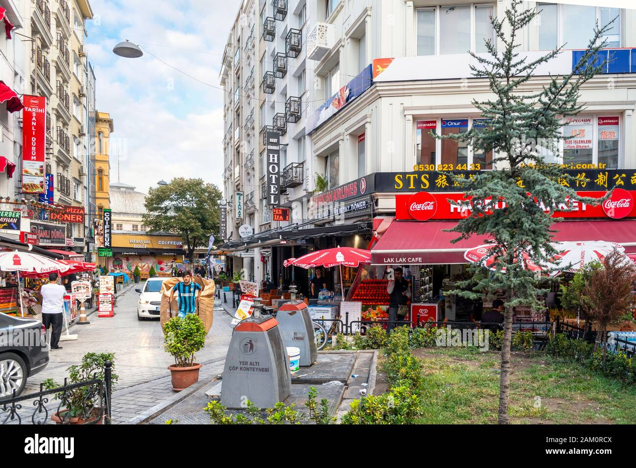 A busy, colorful street corner with cafes, shops and hotels, in the touristic Sultanahmet district of Istanbul, Turkey. Stock Photo