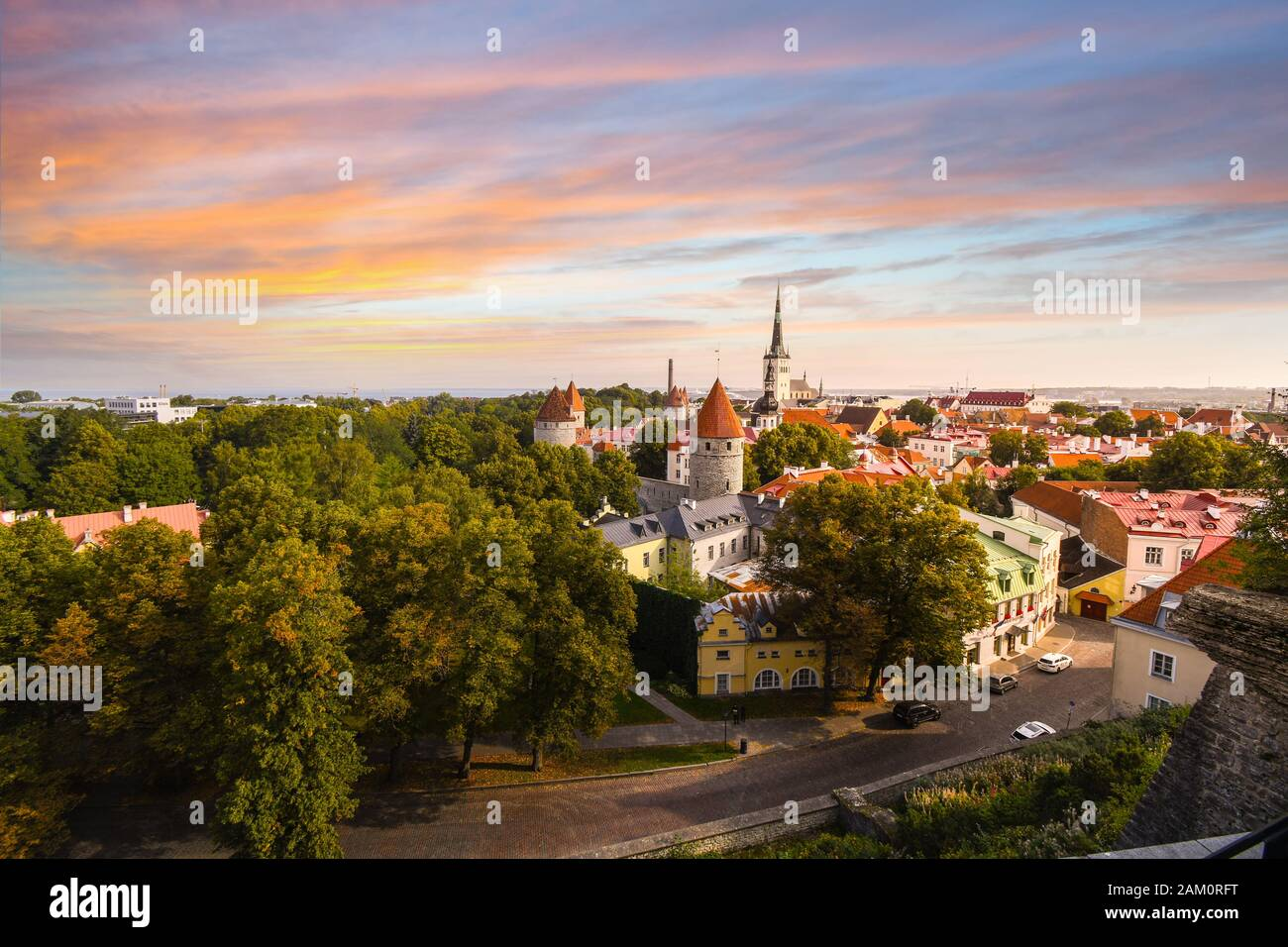A colorful sunset above medieval old town Tallinn Estonia as viewed from upper town Toompea Hill in the European Baltic Region. Stock Photo