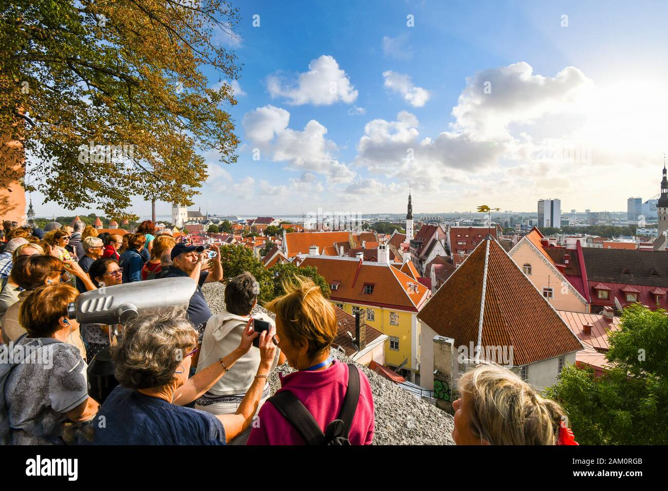 A crowd of tourists group together to take photos over Old Town Tallinn on Toompea Hill, overlooking the medieval Baltic city. Stock Photo