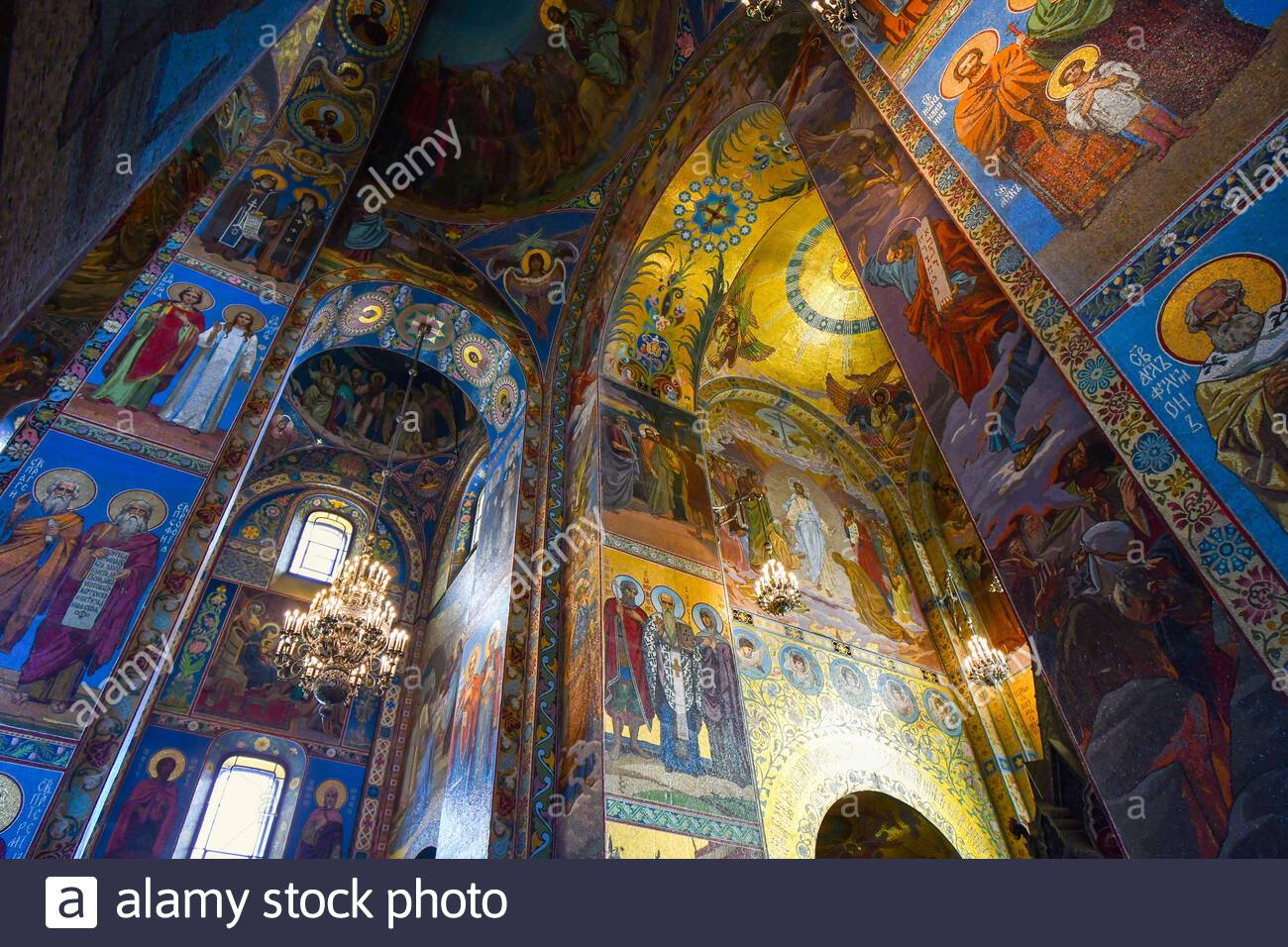 Inside the Church of the Savior on Spilled Blood (Cathedral of Resurrection of Christ) depicting religious scenes in mosaics on the walls and ceiling Stock Photo